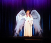 There's Christmas and Drama as this angel shares the coming of a Newborn King!