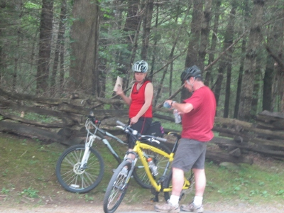 couple bike riding in cades-cove