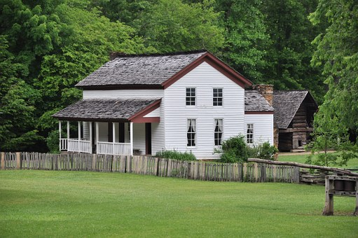 Enjoy historical sites like this Cades Cove Bus Tour house.