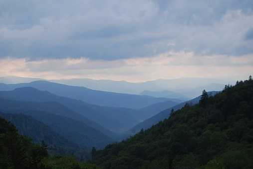 During The Cades Cove Bus Tour you'll be surrounded by lovely mountain views.