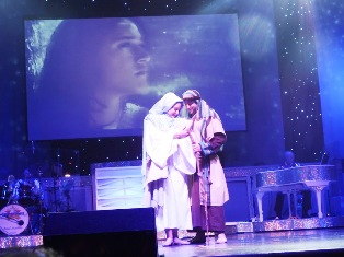 Video plays in the background during A Country Tonite Christmas as Mary and Joseph admire our newborn savior.