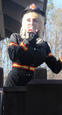 In Dollywood Dolly the fire chief has lots to say about the new Fire Chaser Coaster.