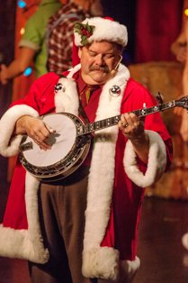 This Hatfield and McCoy Dinner Theater Santa has a tune to pick for the audience.