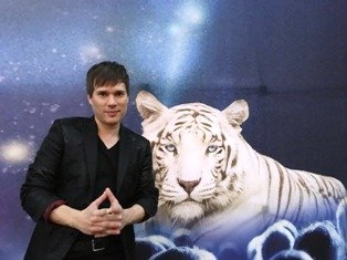 The Magic Beyond Belief Christmas Show features magician Darren Romeo and this beautiful white tiger.