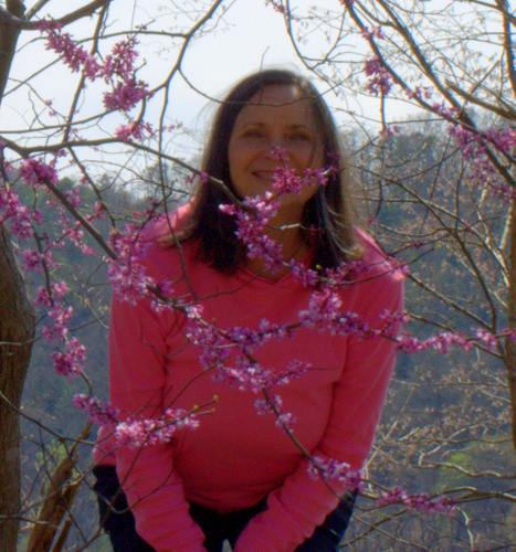 Malia sitting in blossoms in the  Great Smoky Mountains
