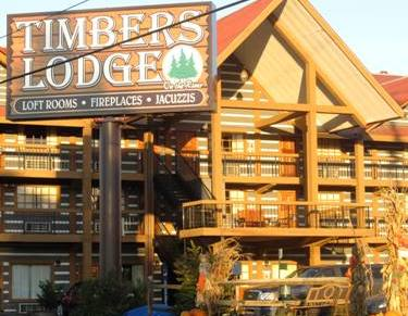 Enjoy the look and feel of a real log cabin at this Pigeon Forge Hotels Timbers Lodge.